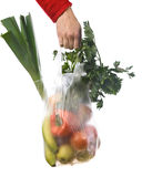 Grocery-bag. Hand of a woman holding a grocery-bag with vegetables and fruits Royalty Free Stock Image