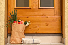 Grocery bag. And Newspaper at the doorstep stock image