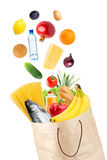 Grocery bag and falling healthy food Royalty Free Stock Image