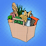 Grocery bag full of food cheese milk bread fruit Royalty Free Stock Image