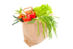 Grocery bag full of fresh vegetables. Isolated on white Royalty Free Stock Photography
