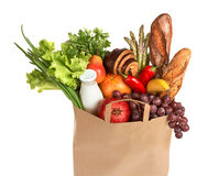 A grocery bag full of healthy fruits and vegetables Stock Photo