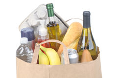 Grocery Bag With Handles. Close shot of a Brown Kraft Paper Bag with Handles full of assorted groceries isolated over white Horizontal format Royalty Free Stock Image
