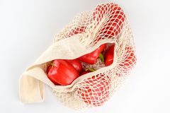 Grocery canvas tote string shopping bag with vegetables on white background. Grocery canvas tote string shopping bag with food. Vegetables in natural bag, eco royalty free stock images