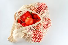 Grocery canvas tote string shopping bag with vegetables on white background. Grocery canvas tote string shopping bag with food. Vegetables in natural bag, eco royalty free stock photography
