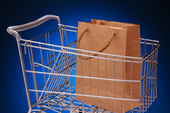 Grocery cart and bag Royalty Free Stock Images