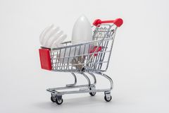 In the grocery cart are light bulbs: energy-saving and LED stock image