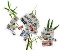 Grocery Coupons On A Tree. A small tree growing money saving grocery coupons Royalty Free Stock Image