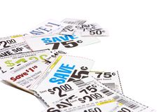 Grocery Coupons On White Background. Assorted manufacturer's grocery coupons photographed on a white background Stock Image