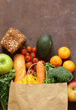 Grocery food shopping bag - vegetables, fruits, bread royalty free stock images