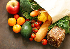 Grocery food shopping bag - vegetables, fruits, bread. And pasta Stock Photos