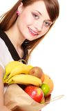 Grocery. Girl holding paper shopping bag with fruits Stock Images