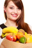 Grocery. Girl holding paper shopping bag with fruits Royalty Free Stock Photos