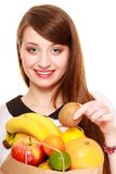 Grocery. Girl holding paper shopping bag with fruits Royalty Free Stock Image