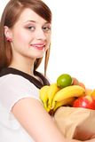 Grocery. Girl holding paper shopping bag with fruits Royalty Free Stock Photography