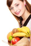 Grocery. Girl holding paper shopping bag with fruits Stock Photo