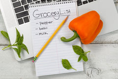Grocery list for online shopping on desktop Stock Photography