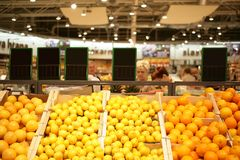 Grocery market. Lemons and oranges in the grocery store Stock Photo