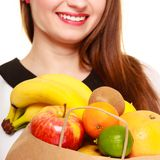 Grocery. Paper shopping bag with fruits in female hands Royalty Free Stock Photos
