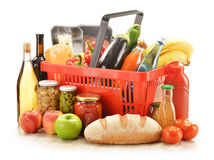 Grocery products in shopping basket Stock Image