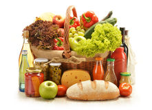Grocery products in shopping basket Royalty Free Stock Photography