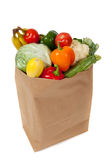 Grocery sack full of vegetables on white royalty free stock photos