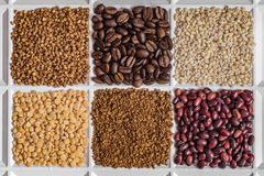 Grocery set of food products. Buckwheat, roasted coffee beans, pearl barley, dried peas, freeze-dried instant coffee, dried seeds of beans Royalty Free Stock Photo