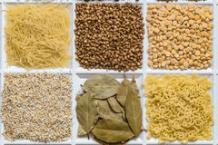 Grocery set of food products. Vermicelli, buckwheat, dried peas, barley grits, bay leafs, figured macaroni Royalty Free Stock Photography