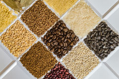 Grocery set of food products. Vermicelli, rice, sunflower seeds, bay leafs, buckwheat, roasted coffee beans, pearl barley, figured macaroni, dried peas, freeze Stock Images