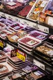 Grocery shelves interior of the popular in Italy grocery Penny Market Express. MILAN, ITALY - 2 JUNE, 2018: Grocery shelves interior of the popular in Italy royalty free stock image