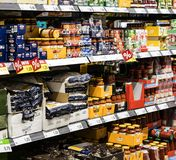Grocery shelves interior of the popular in Italy grocery Penny Market Express. MILAN, ITALY - 2 JUNE, 2018: Grocery shelves interior of the popular in Italy stock photography