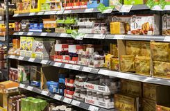 Grocery shelves interior of the popular in Italy grocery Penny Market Express. MILAN, ITALY - 2 JUNE, 2018: Grocery shelves interior of the popular in Italy royalty free stock photo