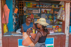 Grocery shop. An unidentified woman buying in a typical grocery shop on Jan 27, 2004 in Ilakaka. Ilakaka is the sapphire city in southern Madagascar royalty free stock image