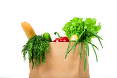 Grocery shop bag with vegetables, salad, bread and other groceries. Isolated Royalty Free Stock Photography