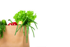 Grocery shop bag with vegetables, salad, bread and other groceries. Isolated Stock Photo