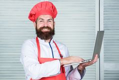 Grocery shop online. Delivery service. Chef laptop at kitchen. Culinary school. Hipster in hat and apron buy products. Online. Shopping online. Man chef royalty free stock photos
