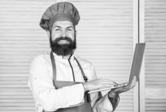 Grocery shop online. Delivery service. Chef laptop at kitchen. Culinary school. Hipster in hat and apron buy products. Online. Shopping online. Man chef royalty free stock photography
