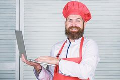 Grocery shop online. Delivery service. Chef laptop at kitchen. Culinary school. Hipster in hat and apron buy products. Online. Shopping online. Man chef stock photo
