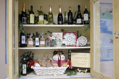 Grocery shop. Shelf with various wines, olive oil and sweets in a grocery store in the medieval town of Caldarola. Marche Region, Italy Stock Image
