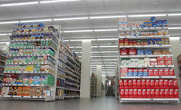 Grocery shop, shelves and products item. Shelving. Shelves with products in a new supermarket opening in Rome (Italy Royalty Free Stock Photo