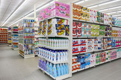 Grocery shop, shelves and products item. Shelving. Shelves with products in a new supermarket opening in Rome (Italy Stock Images