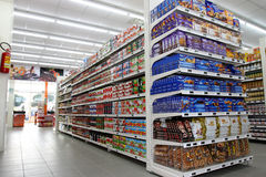 Grocery shop. Shelves with products in a new supermarket opening soon in Rome (Italy Stock Photography
