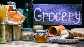 Grocery shop with wood hanging sign Royalty Free Stock Photos