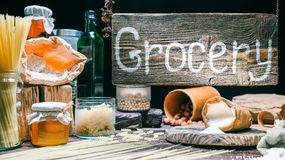 Grocery shop with wood hanging sign Stock Photography