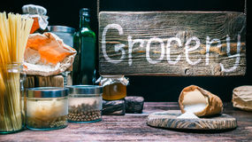 Grocery shop with wood hanging sign Stock Image