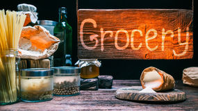 Grocery shop with wood hanging sign Royalty Free Stock Photo