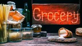 Grocery shop with wood hanging sign Royalty Free Stock Images