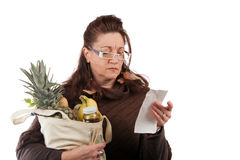 Grocery Shopper Counting Costs Royalty Free Stock Photo