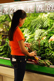 Grocery shopping. A woman shopping at produce section of grocery store Stock Images
