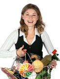Grocery Shopping. Joung woman holding a grocery bag on white Background Stock Photos